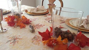 Acorns from the yard into vases with a tea light... and voila! Beautiful Thanksgiving centerpieces. We tried to enjoy the opportunity for craftiness!